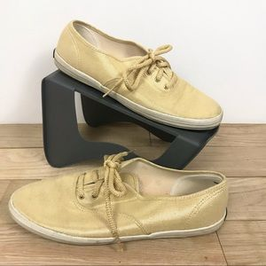 Keds in a gold glitter color